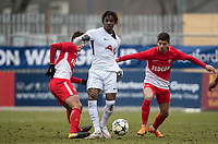 Kazaiah Sterling of Spurs U19 between Adrien Bongiovanni (right) & Julien Serrano of AS Monaco FC Youth during the UEFA Youth League round of 16 match between Tottenham Hotspur U19 and Monaco at Lamex Stadium, Stevenage, England on 21 February 2018. Photo by Andy Rowland.
