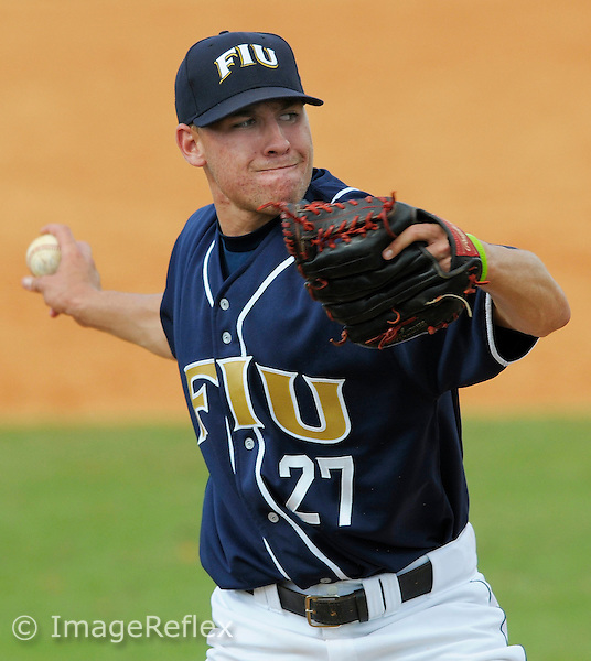 24 February 2008: Florida International pitcher Brian Santana (27) throws to first after fielding a ball in the Southern California 12-7 victory over FIU at University Park Stadium in Miami, Florida.