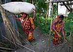 Two women in Kunderpara, a village on an island in the Brahmaputra River in northern Bangladesh.