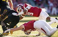 Hawgs Illustrated/BEN GOFF <br /> Derrick Munson (29) and Hayden Henry, Arkansas linebackers, tackle Larry Rountree, Missouri running back in the second quarter Friday, Nov. 24, 2017, at Reynolds Razorback Stadium in Fayetteville.