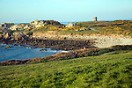 Fort le Marchant headland and loophole 'martello' tower, L'Ancresse bay Guernsey Channel Islands