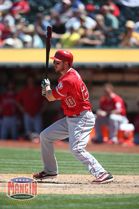 OAKLAND, CA - APRIL 30:  Matt Joyce #20 of the Los Angeles Angels bats against the Oakland Athletics during the game at O.co Coliseum on Thursday, April 30, 2015 in Oakland, California. Photo by Brad Mangin