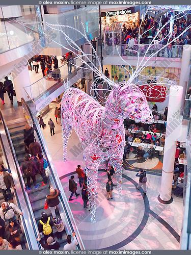 Toronto Eaton Centre shopping mall winter holiday season Christmas decoration of a giant deer in 2012. Toronto, Ontario, Canada.