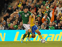 6th September 2013; Robbie Keane, Ireland, in action against Per Nilsson, Sweden. 2014 FIFA World Cup Qualifier, Group C,  Republic of Ireland v Sweden, Aviva Stadium, Dublin. Picture credit: Tommy Grealy/actionshots.ie.