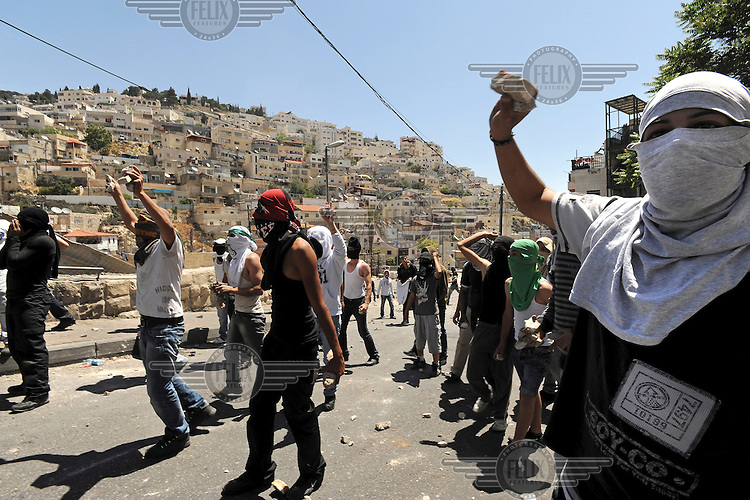 Palestinians clash with Israeli police, as they protest against an ongoing march of ultra right-wing Jewish activists in the Arab neighbourhood of Silwan. The activists have called upon authorities to demolish illegal structures built by Palestinians in Silwan.