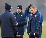 Ally McCoist and his backroom team try to work out team selections at training