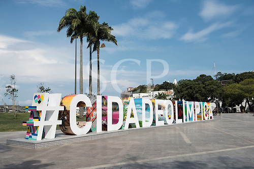 View of Praça Mauá with the #CIDADEOLIMPICA sign prominent in front of palm trees. Olympic Games, Rio de Janeiro, Brazil, 2016.