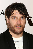 LOS ANGELES - FEB 24:  Adam Pally at the Elton John Oscar Viewing Party on the West Hollywood Park on February 24, 2019 in West Hollywood, CA