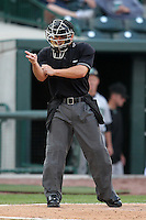 Umpire Ivan Mercado during a game at Dow Diamond in Midland, Michigan;  August 19, 2010.  Photo By Mike Janes/Four Seam Images