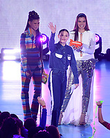 LOS ANGELES, CA - MARCH 24: Storm Reid, Hailee Steinfeld, and Millie Bobby Brown appear on the Nickelodeon Kids Choice Awards 2018 at The Forum on March 24, 2018 in Los Angeles, California. (Photo by Frank Micelotta/PictureGroup)
