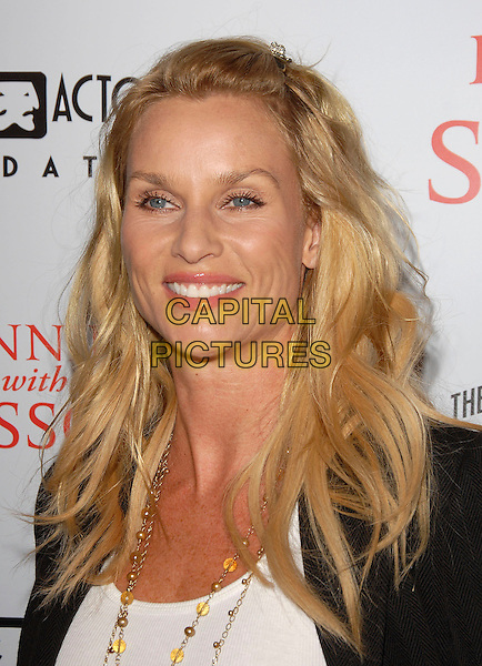 "NICOLLETTE SHERIDAN.attends The TrisStar Pictures' World Premiere of ""Running with Scissors"" held at The Academy of Motion Pictures Arts & Sciences in Beverly Hills, California, USA, October 10th 2006..portrait headshot Nicolette.Ref: DVS.www.capitalpictures.com.sales@capitalpictures.com.©Debbie VanStory/Capital Pictures"