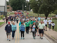 NWA Democrat-Gazette/SPENCER TIREY   Participants walk down Northwest Brave Lane in Bentonville, Sunday, Sept. 9, 2018 in the NWA Out of Darkness Walk.  Hundreds of people walked in the 5th annual walk to support the American Foundation for Suicide Prevention. The goal is to reduce the annual suicide rate 20 percent by 2025.