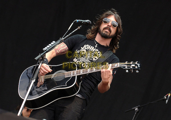 FOO FIGHTERS - DAVE GROHL.Performing live at the 2007 V Festival, Hylands Park, Chelmsford, England..18th August 2007.half length stage concert live gig performance music guitar singing sunglasses shades black t tee shirt tattoo.CAP/BEL.©Belcher/Capital Pictures