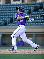 Right fielder Taylor Johnson (23) of the Furman Paladins hits in a game against the Miami (Ohio) Redhawks on Sunday, February 17, 2013, at Fluor Field at the West End in Greenville, South Carolina. Furman won, 6-5. (Tom Priddy/Four Seam Images)