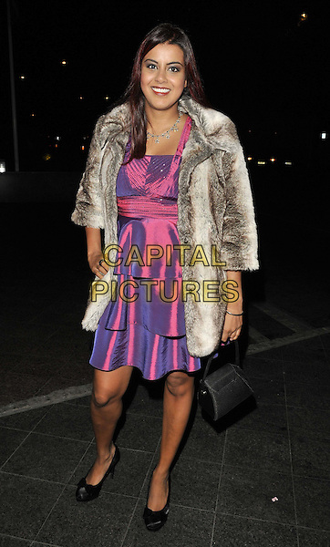 Pooja Shah. .attended the Rhys Daniels Trust Butterfly Ball, Lancaster London hotel, Lancaster Terrace, London, England, UK, .19th November 2011..full length pink purple shiny tiered dress fur coat jacket .CAP/CAN.©Can Nguyen/Capital Pictures.
