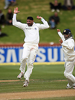 India's Harbahjan Singh celebrates the dismissal of Jesse Ryder for a duck with Gautam Gambhir during day four of the 3rd test between the New Zealand Black Caps and India at Allied Prime Basin Reserve, Wellington, New Zealand on Monday, 6 April 2009. Photo: Dave Lintott / lintottphoto.co.nz.