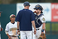 Queens Royals catcher Ryan Dudney (15) listens to head coach Jack McDowell during the game against the Mars Hill Lions at Intimidators Stadium on March 30, 2019 in Kannapolis, North Carolina. The Royals defeated the Bulldogs 11-6 in game one of a double-header. (Brian Westerholt/Four Seam Images)