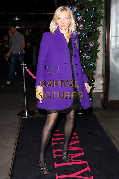 JO WHILEY.The Jimmy Choo Project Pep launch party, Selfridges, London, England..October 29th, 2009 .full length black dress purple coat jacket ruffle .CAP/AH.©Adam Houghton/Capital Pictures.