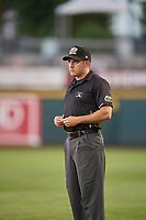 First base umpire Lee Meyers handles the calls on the bases during the game between the Reno Aces and the Nashville Sounds at Greater Nevada Field on June 5, 2019 in Reno, Nevada. The Aces defeated the Sounds 3-2. (Stephen Smith/Four Seam Images)