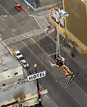In this photo provided by the Reno Sparks Convention and Visitor's Authority, Squaw Valley freeride team member J.T. Holmes performs an urban Ski-BASE jump off a ramp built on the roof of the Silver Legacy hotel casino in downtown Reno, Nev., Saturday Nov. 17, 2007. The stunt was to promote the local premier of the 2007 Warren Miller ski movie Playground and to raise money for the Make-a-Wish foundation, which helps make wishes come true for seriously ill children.(Reno Sparks Convention and Visitor's Authority)