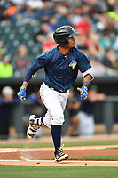 Second baseman Luis Carpio (18) of the Columbia Fireflies runs toward first in a game against the Lakewood BlueClaws on Saturday, May 6, 2017, at Spirit Communications Park in Columbia, South Carolina. Lakewood won, 1-0 with a no-hitter. (Tom Priddy/Four Seam Images)