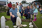 © Joel Goodman - 07973 332324 . 14 September 2013 . Ramsbottom Cricket Club , Ramsbottom , UK . JAMES BRUNT of Responsible Fishing UK stone balancing . The Ramsbottom Festival . Photo credit : Joel Goodman