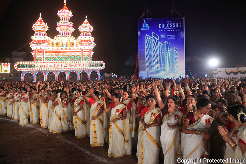 Largest kaikottikali dance - Mumbai, INDIA - 9th of NOVEMBER 2012<br /> Record to break: 250    New record: 2639<br /> <br /> An Amazing 2639 Indian women, beautifully  clad in white Kerala sarees or Mundu, got together in Mumbai to break the record for the largest Kaikottikali dance. Kaikottikali (also known as Thiruvathirakkali   )is a famous women's group dance form of Kerala in the south of India.<br /> This event was held during MUMBAI POORAM festival and attracted an audience of around 75000. Mumbai Pooram Foundation, a registered Charitable Trust was attempting to perform biggest kaikottikkali , a traditional Kerala group dance form normally performed with 8-10 ladies/girls positioned in circular formation. It involved around 3000 ladies and girls attired in traditional Kerala Sari/Mundu to participate in this dance form &amp; helped by hundreds of volunteers.  A Kaikottikkali of this magnitude of around 20 circles was  an excellent sight to watch and it aimed to reach the wonderful dance form all over the world.  Besides, a strong message of communal harmony was given as the participants represented all the major religions of India.