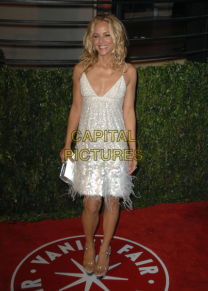 MARIA BELLO.The 2010 Vanity Fair Oscar Party held at The Sunset Tower Hotel in West Hollywood, California, USA..March 7th, 2010.oscars full length white silver dress paillettes sequins sequined feathers clutch bag sequins sequined.CAP/RKE/DVS.©DVS/RockinExposures/Capital Pictures.