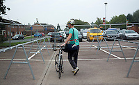 28 SEP 2014 - STOWMARKET, GBR - Adam Fish from Stowmarket Striders Running Club makes an early start to his preparations as he walks past still empty racks to his spot in transition as he prepares for the start of the 2014 West Suffolk Triathlon in Stowmarket in Suffolk, Great Britain (PHOTO COPYRIGHT © 2014 NIGEL FARROW, ALL RIGHTS RESERVED)