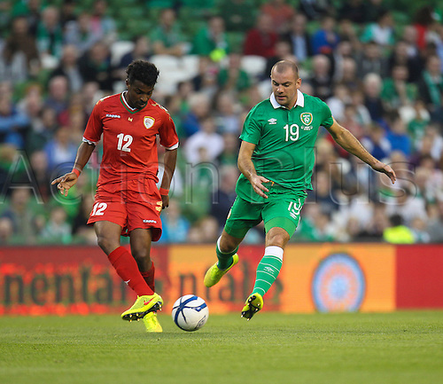 3.09.2014. Dublin, Ireland.  International friendly fixture Republic of Ireland versus Oman. Darron Gibson (Ireland) keeps a close cover on Ahmed Al Muhaijri (Oman).