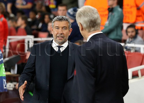 28.09.2016. Emirates Stadium, London, England. UEFA Champions League Football. Arsenal versus FC Basel. Basel Manager Urs Fischer (left) is greeted by Arsenal Manager Arsène Wenger