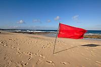 Red flag on Corralejo beach, Fuerteventura, Canary Islands, Spain.