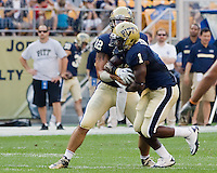 Pitt running back Ray Graham (1) receives a handoff from quarterback Tino Sunseri (12).. The Pittsburgh Panthers beat the Buffalo Bulls 35-16 at Heinz field in Pittsburgh, Pennsylvania on September 3, 2011