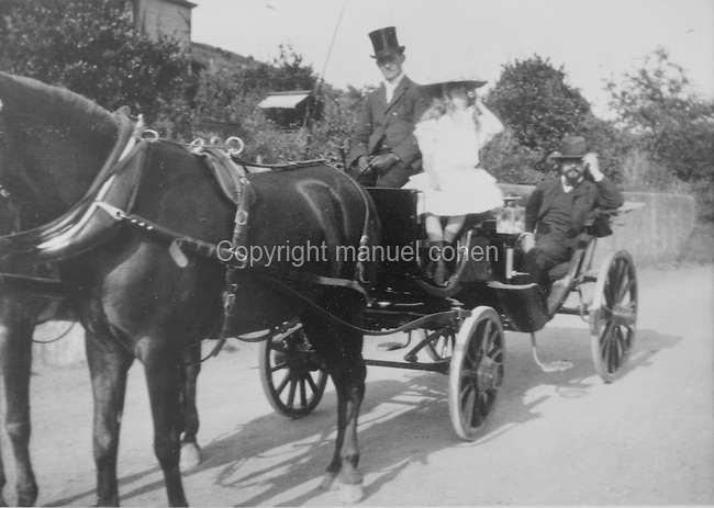 Claude Debussy, 1862-1918, French composer, and his daughter Chouchou riding in a horse-drawn carriage in Jersey in the Channel Islands, photograph. Copyright © Collection Particuliere Tropmi / Manuel Cohen