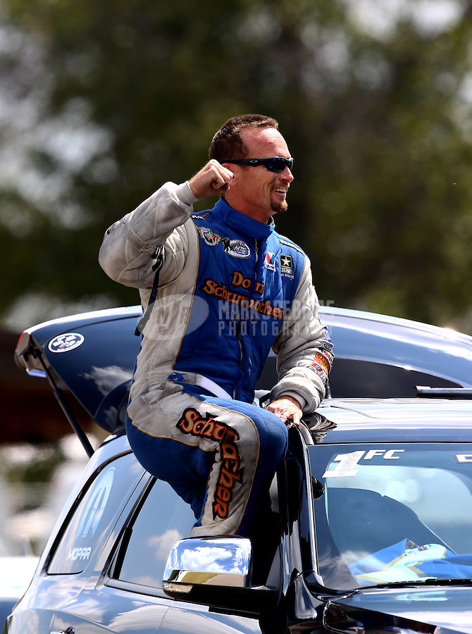 Aug. 17, 2013; Brainerd, MN, USA: NHRA funny car driver Jack Beckman celebrates after taking the top qualifying spot during qualifying for the Lucas Oil Nationals at Brainerd International Raceway. Mandatory Credit: Mark J. Rebilas-