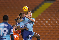 Luke O'Nien & Marcus Bean of Wycombe Wanderers go for the ball during the The Checkatrade Trophy match between Blackpool and Wycombe Wanderers at Bloomfield Road, Blackpool, England on 10 January 2017. Photo by Andy Rowland / PRiME Media Images.
