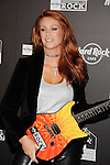 HOLLYWOOD, CA. - October 21: Angie Everhart arrives at the Hard Rock Cafe - Hollywood - Grand Opening on October 21, 2010 in Hollywood, California.