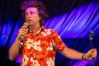 20th July 2014: English king of the one liners Milton Jones plays the Comedy Arena on the fourth day of the 9th edition of the Latitude Festival, Henham Park, Suffolk.<br /> Picture by Stuart Hogben