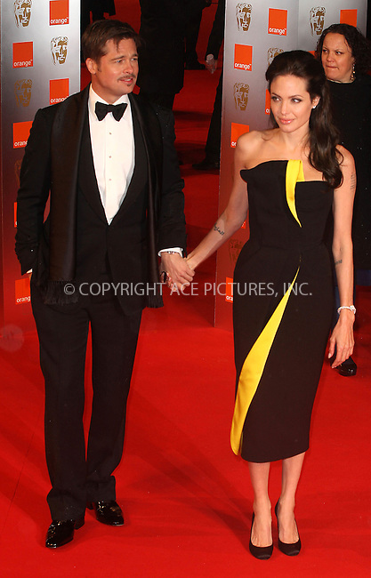 Brad Pitt and Angelina Jolie at The Orange British Academy Film Awards (BAFTA) 2009 held at the Royal Opera House in London - 08 February 2009..FAMOUS PICTURES AND FEATURES AGENCY 13 HARWOOD ROAD LONDON SW6 4QP UNITED KINGDOM tel +44 (0) 20 7731 9333 fax +44 (0) 20 7731 9330 e-mail info@famous.uk.com www.famous.uk.com.FAM25192