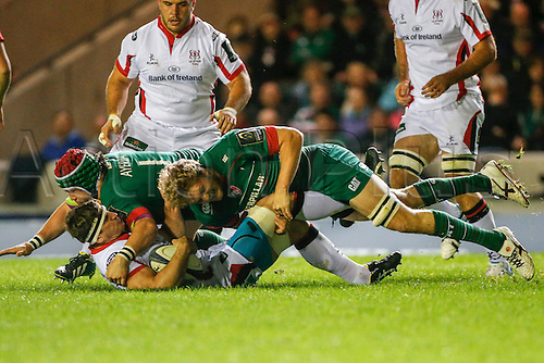 18.10.2014.  Leicester, England.  European Rugby Champions Cup. Leicester Tigers versus Ulster.  Robbie Diack of Ulster Rugby is tackled by Jamie Gibson (front) and Marcos Ayerza of Leicester Tigers.   Final score: Leicester Tigers 25-18 Ulster Rugby.