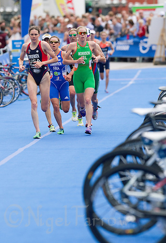 17 JUL 2011 - HAMBURG, GER - Gwen Jorgensen (USA), Emmie Charayron (FRA) and Aileen Morrison (IRL) lead a pack onto their next lap of the run during the women's Hamburg round of triathlon's ITU World Championship Series (PHOTO (C) NIGEL FARROW)