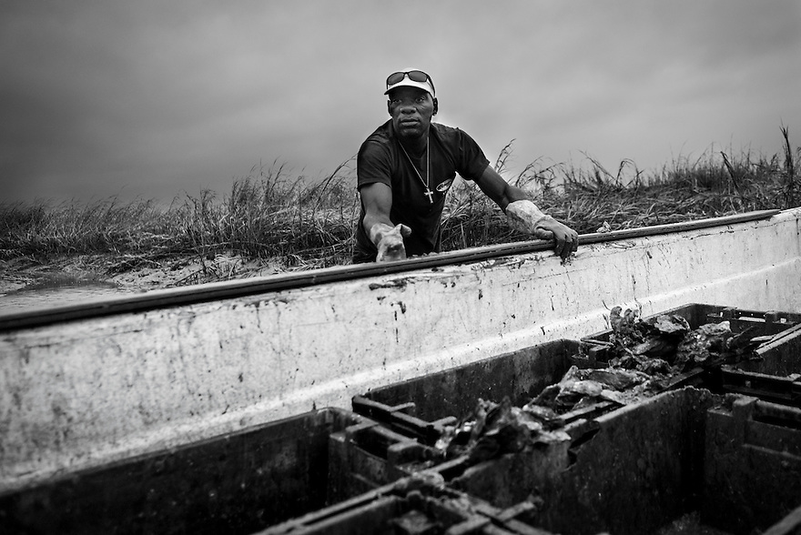 "Anthony ""Drack"" Mervin, an independent oysterman who works out of Bluffton Oyster Company in Bluffton, S.C., harvests oysters in the May River near Hilton Head Island. Harvesting oysters is a dangerous job. In 1999, a young Gullah Geechee oysterman named Tyrone Smith fell from his boat while hauling in a load of oysters. As Smith's hip waders filled with water, he was pulled under and drowned"