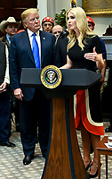 First Daughter and Advisor to the President Ivanka Trump, right, delivers remarks on United States 5G deployment, addressing efforts to boots rural broadband internet access, in the Roosevelt Room at the White House in Washington, DC on April 12, 2019.  Looking on from left is US President Donald J. Trump. Credit: Leigh Vogel / Pool via CNP/AdMedia