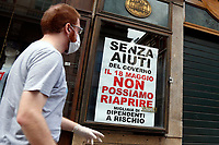 Roma May 20th 2020. Covid-19 Italy further relaxes lockdown. After Italy further eased the restrictions two days ago, many shops in centre of Rome and near St Peter's basilica, remain closed due to  the lack of tourists and faithfuls. On many closed shutters were put up signs asking the Government an economic help.<br /> Photo Samantha Zucchi Insidefoto