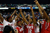 The Wolfpack celebrate thier victory over the No. 5 Blue Devils. NC State defeated Duke 75-73 during quarter finals of the 2012 ACC Women's Basketball Tournament at the Greensboro Coliseum in Greensboro, NC. Photo by Al Drago.