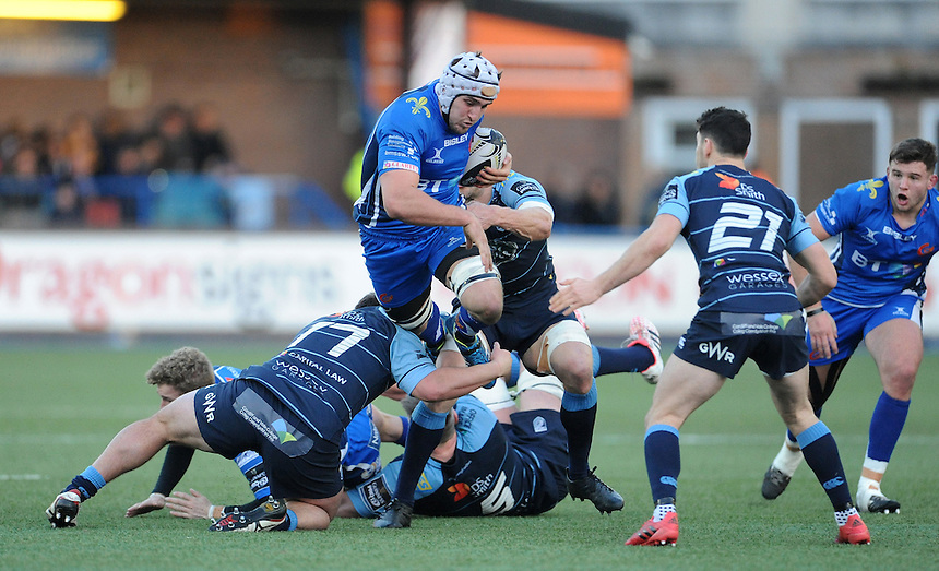 Dragons' Ollie Griffiths is tackled by Cardiff Blues' Bradley Thyer<br /> <br /> Photographer Ian Cook/CameraSport<br /> <br /> Guinness PRO12 Round 11 - Cardiff Blues v Newport Gwent Dragons - Monday 26th December 2016 - Cardiff Arms Park - Cardiff<br /> <br /> World Copyright &copy; 2016 CameraSport. All rights reserved. 43 Linden Ave. Countesthorpe. Leicester. England. LE8 5PG - Tel: +44 (0) 116 277 4147 - admin@camerasport.com - www.camerasport.com