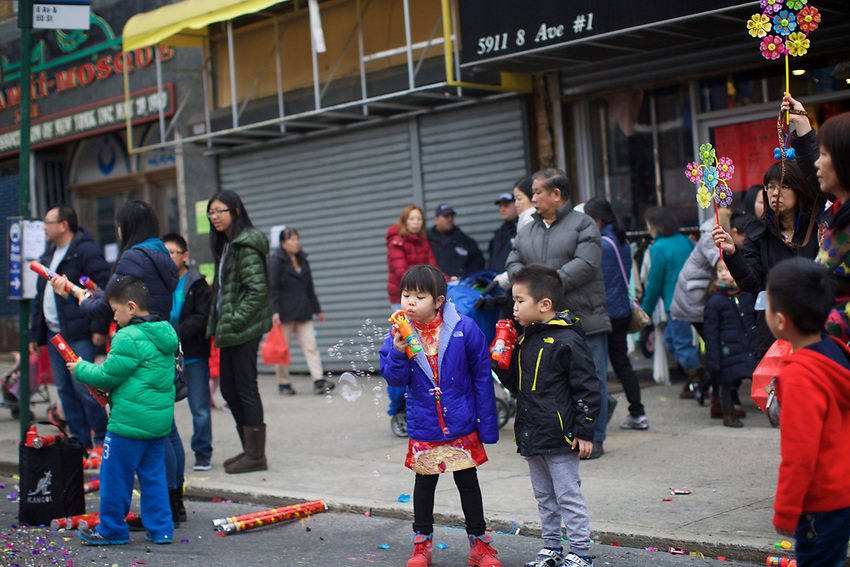 Brooklyn, NY - February 21, 2016: The street festival celebrating the Lunar New Year, the year of the Monkey, in Brooklyn's Chinatown, in Sunset Park.<br /> CREDIT: Clay Williams <br /> Clay Williams / claywilliamsphoto.com