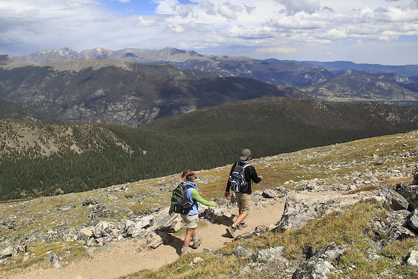 Caucasian couple hiking the Flattop Mountain Trail in Rocky Mountain National Park, west of Estes Park, Colorado. .  John leads hikes and private photo tours in Boulder and throughout Colorado. Year-round.