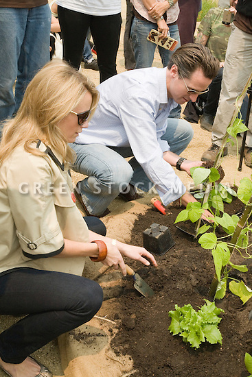 "San Francisco Mayor Gavin Newsom and Jennifer Siebel, fiancee, at Community Planting Day (July 12, 2008) of the Slow Food Nation Victory Garden at San Francisco's Civic Center. The garden project ""demonstrates the potential of a truly local agriculture practice that unites and promotes Bay Area urban gardening organizations, while producing high quality food for those in need.""* The garden is planted on the same site as the post-World War II garden sixty years ago. The food will be grown over a period of two months, harvested, and donated to people in need..*slowfoodnation.org"