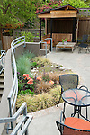 Patio seating in a multi-level garden of a Pacific Northwest home.  Design by Maggi Johnson / Johnson-Southerland.